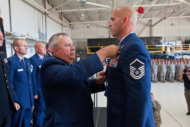 Brig. Gen. Michael L. Cunniff, left, The Adjutant General of New Jersey, presents Master Sgt. Michael F. Sears, 177th Fighter Wing, the Silver Star, the third highest military award, June 28, 2014, during a ceremony at the 177th at Egg Harbor Township, N.J., for actions while deployed to Afghanistan on Sept. 29, 2012.  (U.S. Air National Guard photo by Master Sgt. Mark C. Olsen)