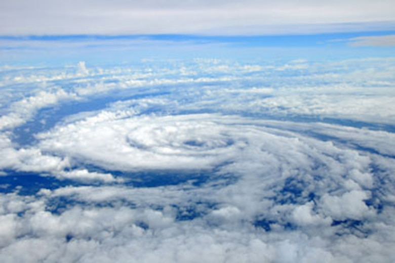 "The center of circulation of a tropical storm can be seen as the WC-130J aircraft flies over the eye. The 53rd Weather Reconnaissance Squadron ""Hurricane Hunters,"" were heading back to Keesler Air Force Base in Biloxi, Miss, after penetrating the storm. (U.S. Air Force photo by Staff Sgt. Valerie Smock)"