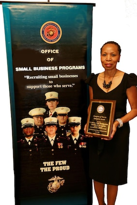 Hattie Mosely, director, Small Business Program Office, Marine Corps Logistics Command, displays the Champions of Veteran Enterprise Award she accepted on behalf of Headquarters Marine Corps' Installations and Logistics June 17 at the 2014 Veteran Entrepreneur Training Symposium.