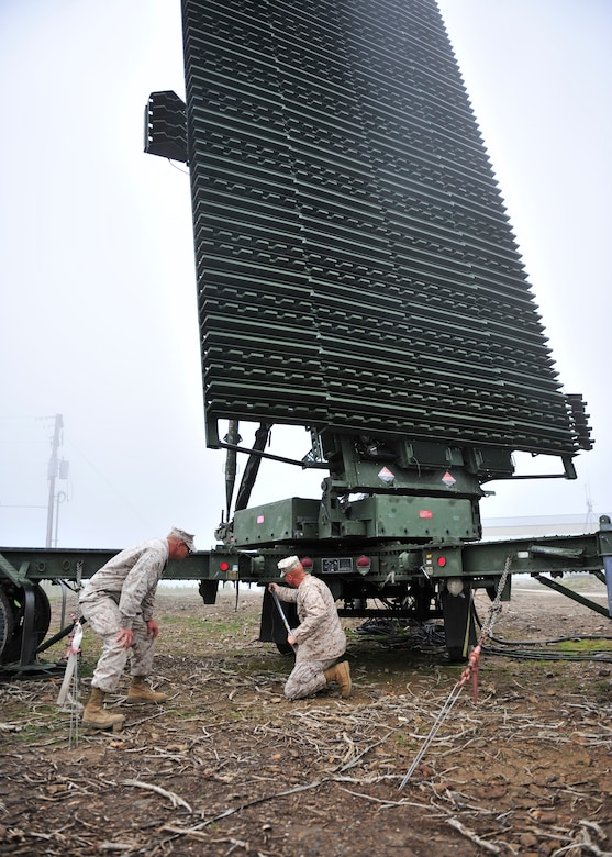 U.S. Marine Corps Gunnery Sgt. Alfredo Franco,  Marine Air Control Squadron 2, and Chief Warrant Officer 2 James Haunty, MACS-2 maintenance officer both assigned to Marine Corps Air Station Cherry Point, N.C., torque swing bolts on an AN/TPS-59 long range radar during Red Flag-Alaska 14-2 June 24, 2014, Joint Pacific Alaska Range Complex, Alaska. The AN/TPS-59 is a 3-D radar that detects an aircraft's height and altitude to positively control them and find hostile aircraft. (U.S. Air Force photo by Senior Airman Ashley Nicole Taylor/Released)