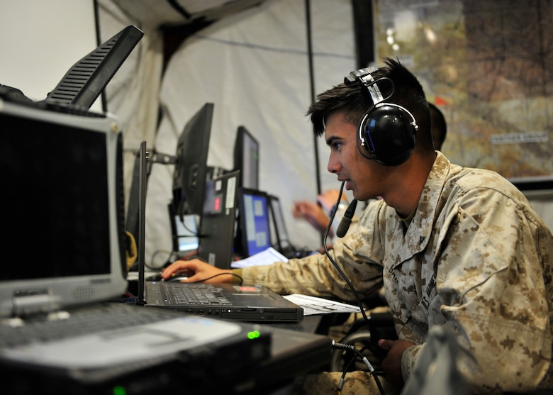U.S. Marine Corps Lance Cpl. Alexander Banus, Marine Air Control Squadron 2 radar controller assigned to Marine Corps Air Station Cherry Point, N.C., communicates with an aircraft during Red Flag-Alaska 14-2 June 24, 2014, Joint Pacific Alaska Range Complex, Alaska. RF-A provided the Marine Air Control Agency with a live flight venue that has more aircraft flying during each event and gave operators a better feel of what they can expect in a combat situation (U.S. Air Force photo by Senior Airman Ashley Nicole Taylor/Released)