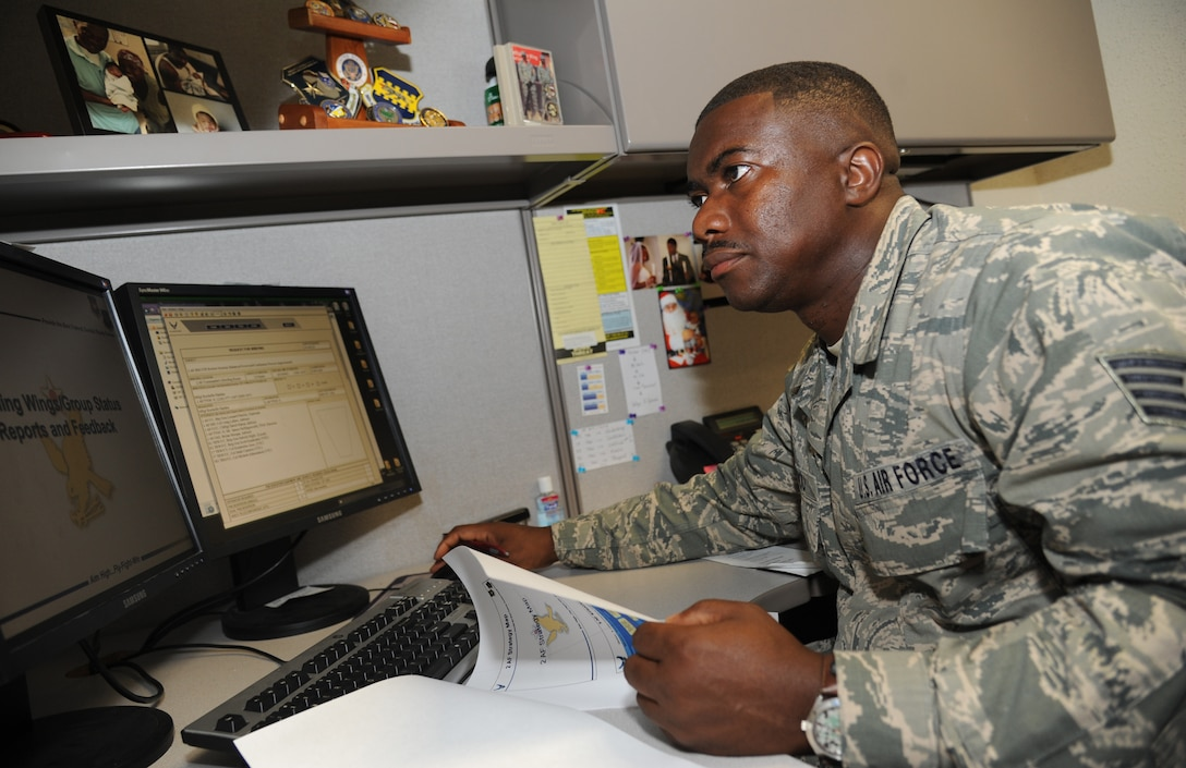 Staff Sgt. Joseph Boyou, 2nd Air Force, reviews slides for a final review session for 2nd AF, 81st Training Wing and the 81st Training Group July 1, 2014, at Keesler Air Force Base, Miss.  Boyou was born in Liberia, West Africa and escaped the civil war there when he was a child. Boyou wrote a memoir telling his story of overcoming adversity. It is scheduled to be released later this summer. (U.S. Air Force photo by Kemberly Groue)