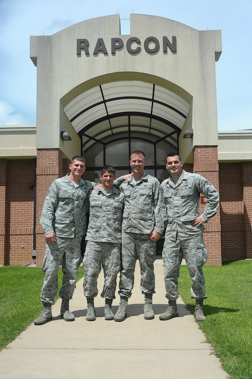 Staff Sgt. Alexander Gordy, Airman 1st Class Kyle Carpenter, Senior Airman Ryan Werner and Staff Sgt. Joshua Keith, 14th Operations Support Squadron, pose for a photo June 24 outside their place of work, the Radar Approach Control. The Airmen demonstrated the Air Force Core Value of Service Before Self by saving a drowning man, May 26, 2014, at the Buttahatchee river in Caledonia, Miss. (U.S. Air Force photo/ Airman John Day)