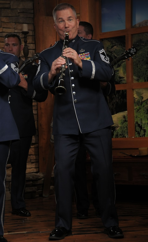 U.S. Air Force Chief Master Sgt. Jurgen Schwarze, member of the Tailgaters with the Air National Guard band of the West Coast performs on the Park City Television Station in Park City, Utah on July 1, 2014. (U.S. Air Natioal Guard photo by Airman 1st Class Madeleine Richards/Released)