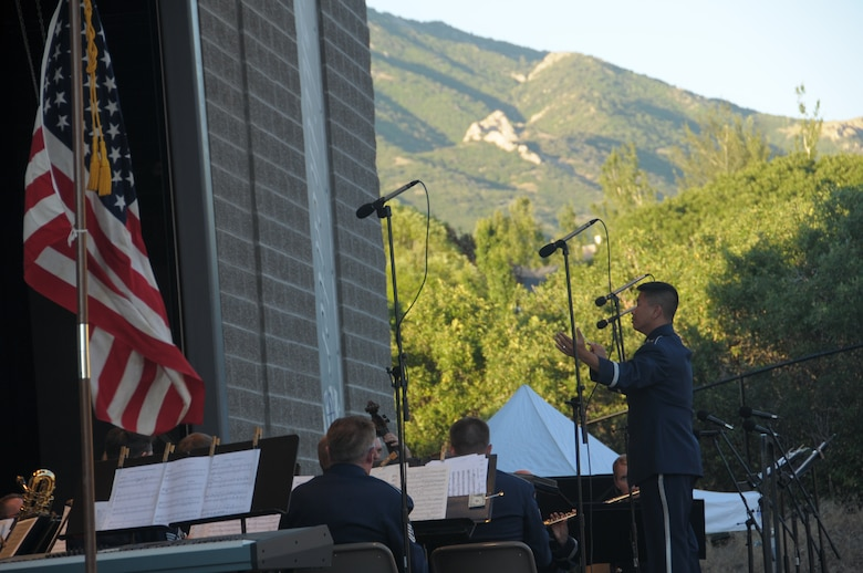 U.S. Air Force Capt. Vu Nguyen, commander of the 562nd Air Force Band of the West Coast, conducts the band at a performance at the Draper City Amphitheater in Draper City, Utah on July 1, 2014. (U.S. Air National Guard photo by Airman 1st Class Madeleine Richards/Released)