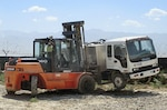 A truck is moved in preparation for the first sale of useable non-military property at Bagram Airfield, Afghanistan, June 25, 2014. Photo by Kathy Wigginton