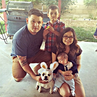 """Yesenia Ruiz-Rojo with her husband, stepson and """"miracle"""" baby, Luke, this Easter at her family's home in California. Courtesy photo"""