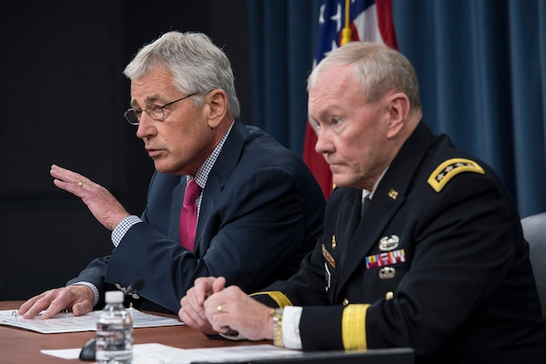 Defense Secretary Chuck Hagel and Army Gen. Martin E. Dempsey, chairman of the Joint Chiefs of Staff, brief reporters at the Pentagon, July 3, 2014. DoD photo by Navy Petty Officer 1st Class Daniel Hinton