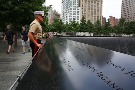 Brigadier Gen. Vincent Coglianese, 1st Marine Logistics Group Commanding General, looks out at the 9/11 World Trade Center Memorial fountain before going on a tour of the 9/11 Museum in New York City, June 25, 2014. Brigadier Gen. Coglianese traveled to New York to officiate Col. James Maxwell's retirement ceremony Maxwell, a New York State trooper and Marine, served 32 in the Marine Corps. During his career he served in Operation Desert Shield, Operation Desert Storm and Operation Enduring Freedom.