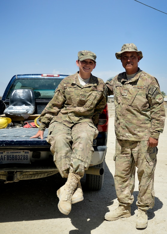 Senior Airman Kimberly Buzzell, left, and Tech. Sgt. John Trujillo, pose for a photograph July 1, 2014, at Bagram Airfield, Afghanistan.  The father and daughter team, originally fromTurner, Maine, is assigned to Task Force Signal and deployed together from the Air National Guard's 243rd Engineering Installation Squadron in South Portland, Maine. Trujillo is a cable and antenna team chief while Buzzell is a radio frequency transmissions technician. (U.S. Air Force photo/Staff Sgt. Evelyn Chavez)