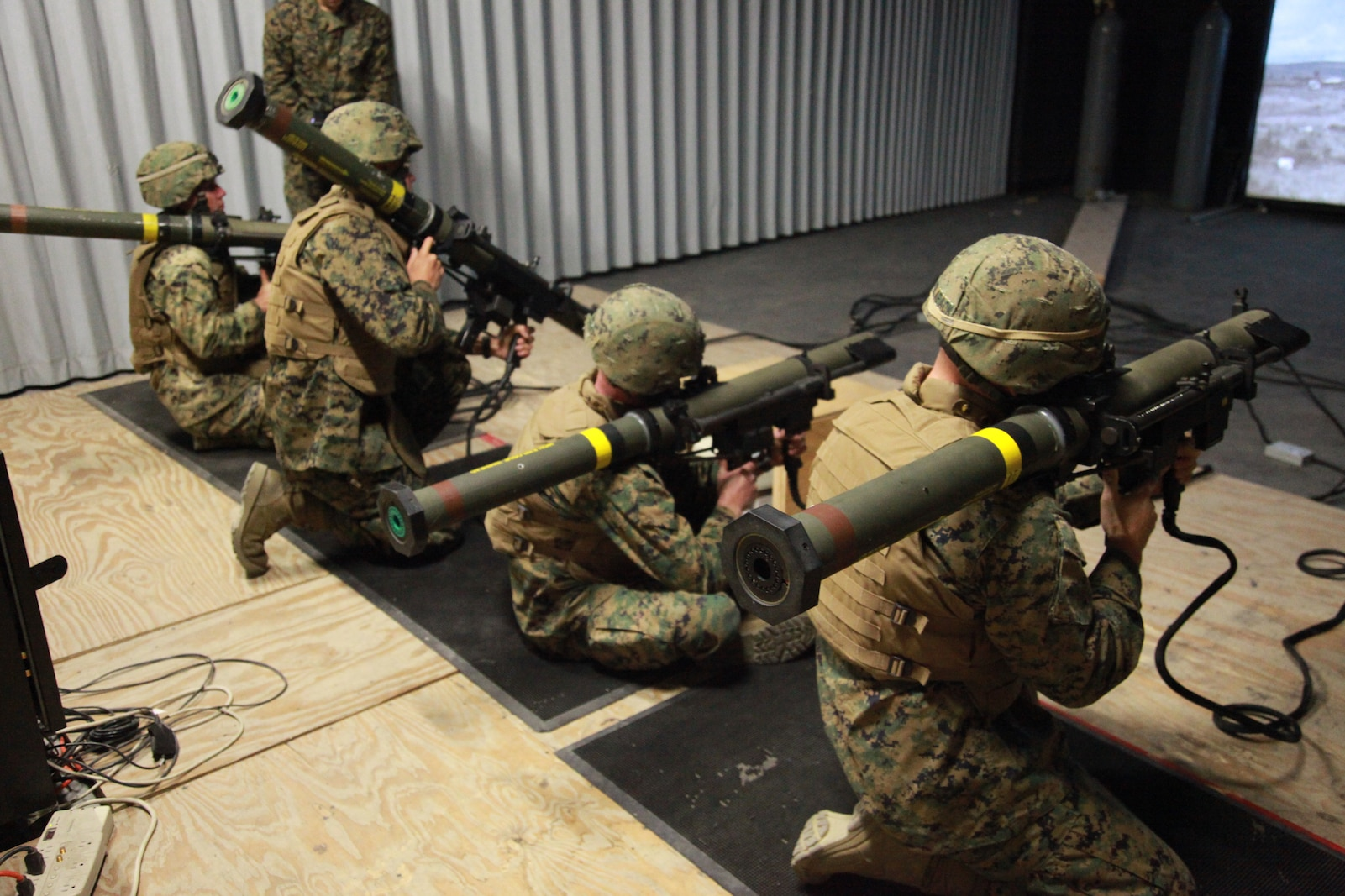 U.S. Marines with Weapons Platoon, Lima Company, 3rd Battalion, 1st Marine Regiment practice marksmanship with the shoulder-launched multipurpose assault weapon in the indoor simulated marksmanship trainer at Camp Horno, at Camp Pendleton, Calif., Nov. 24, 2009. The 3rd Battalion is preparing for upcoming deployments. (U.S. Marine Corps photo by Lance Cpl. Brandyn E. Council/Released)
