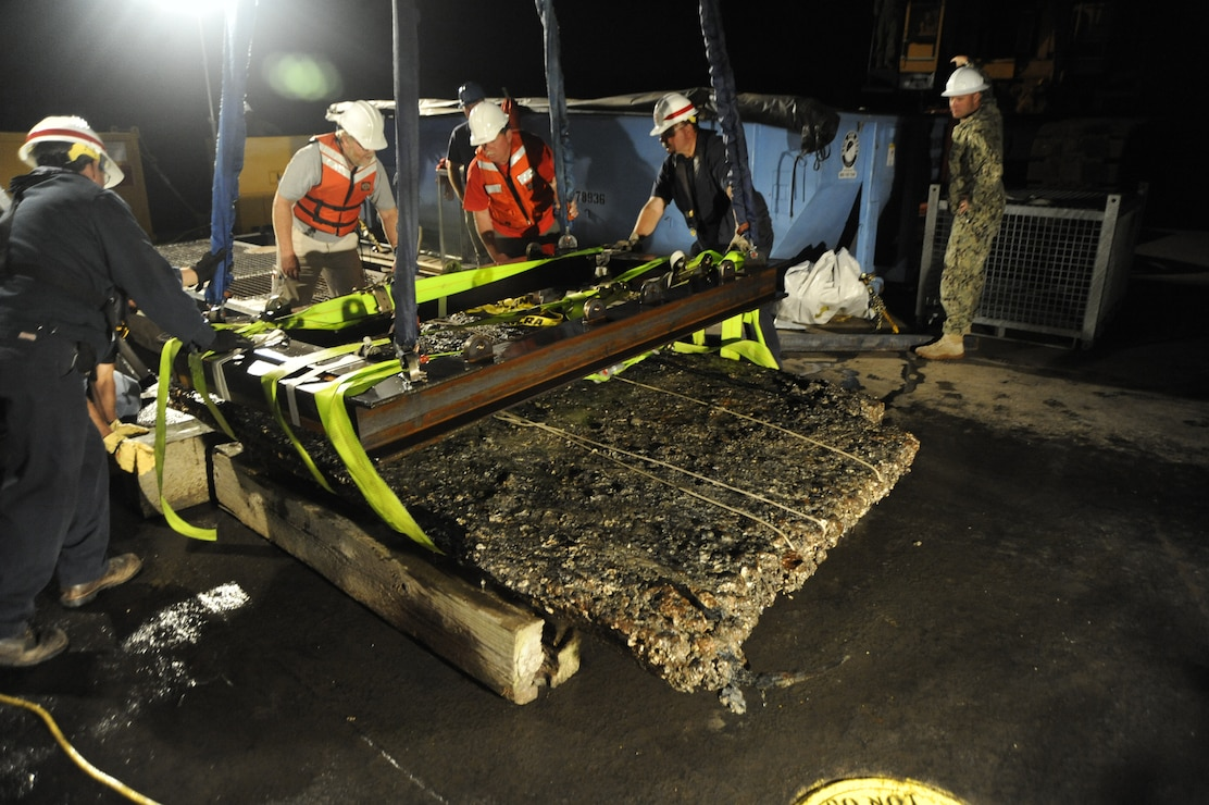 Archeologists working for the U.S. Army Corps of Engineers, Savannah District, and divers and salvage operations teams from the U.S. Navy, retrieve a 64-square foot section of a Civil War ironclad warship from the bottom of the Savannah River the evening of Nov. 12, 2013. U.S. Navy photo. (Photo by US Navy)