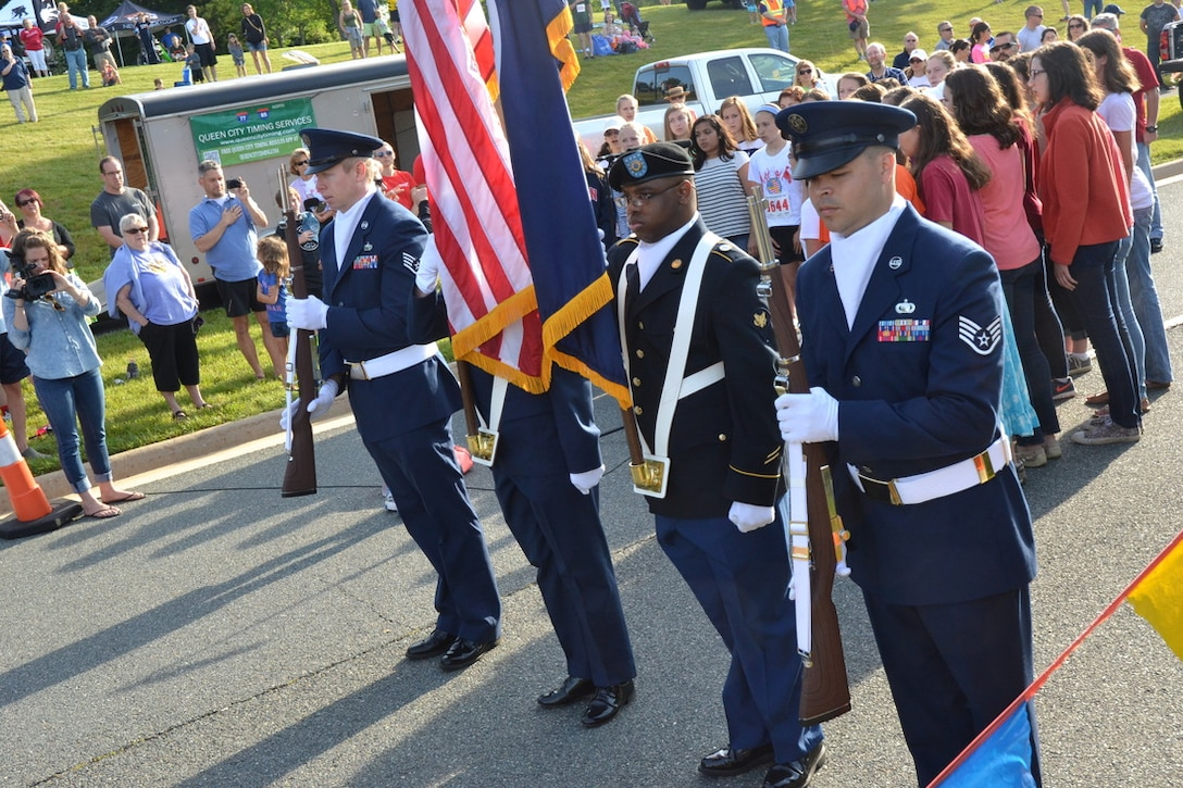 Members of DIA's Color Guard in Charlottesville, Va., present the colors during the 4 the Wounded 5K race.