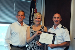"Eric Bush, chief of the Planning and Policy Division (left) and Col. Alan Dodd, district commander (right) present Patrice Morey with the 2014 Professional Analytical Employee of the Year award. ""Patrice demonstrates the highest personal standards of quality and integrity,"" said Bush."