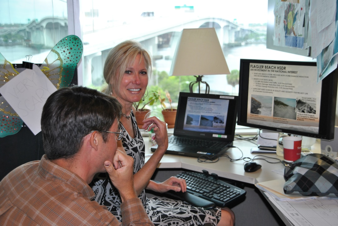 "Patrice Morey, technical writer/editor, collaborates with Marty Durkin, project manager, on an information product that will explain the Flagler Beach Hurricane and Storm Damage Reduction Project to the public. Morey enjoys working with many district teams in developing products that ""make a difference."""