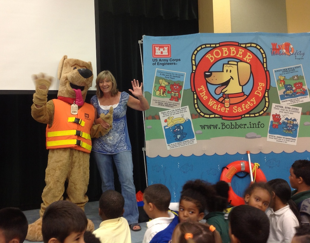 Ellen Smith, gym and wellness teacher at Gove Elementary School in Belle Glade, Florida welcomes Bobber the Water Safety Dog to her class.