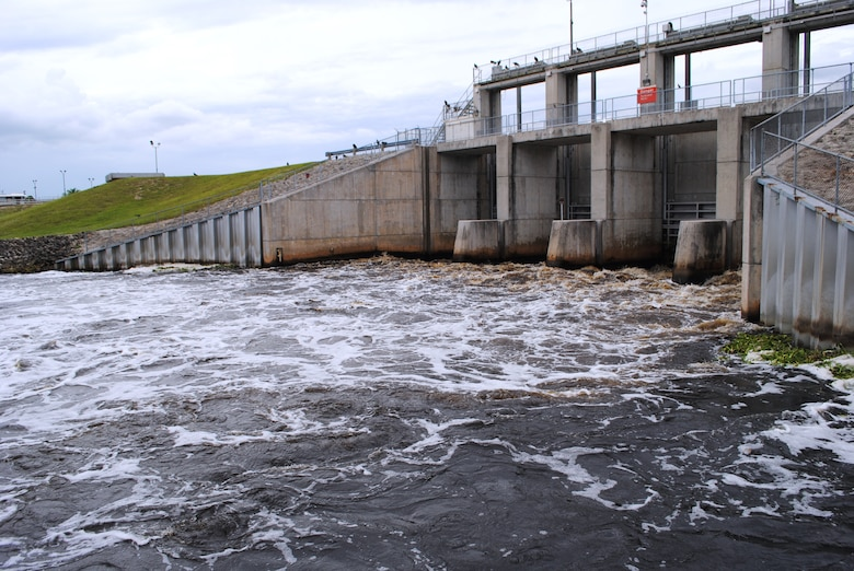 Water flows from Lake Okeechobee into the Caloosahatchee River at the Moore Haven lock and dam. Flows during 2014 have been much closer to normal following heavy precipitation at the beginning of the 2013 wet season.