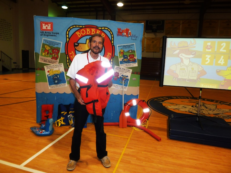 "Water safety volunteer Bill Wagner teaches students how to ""Wear it tight and wear it right!"""