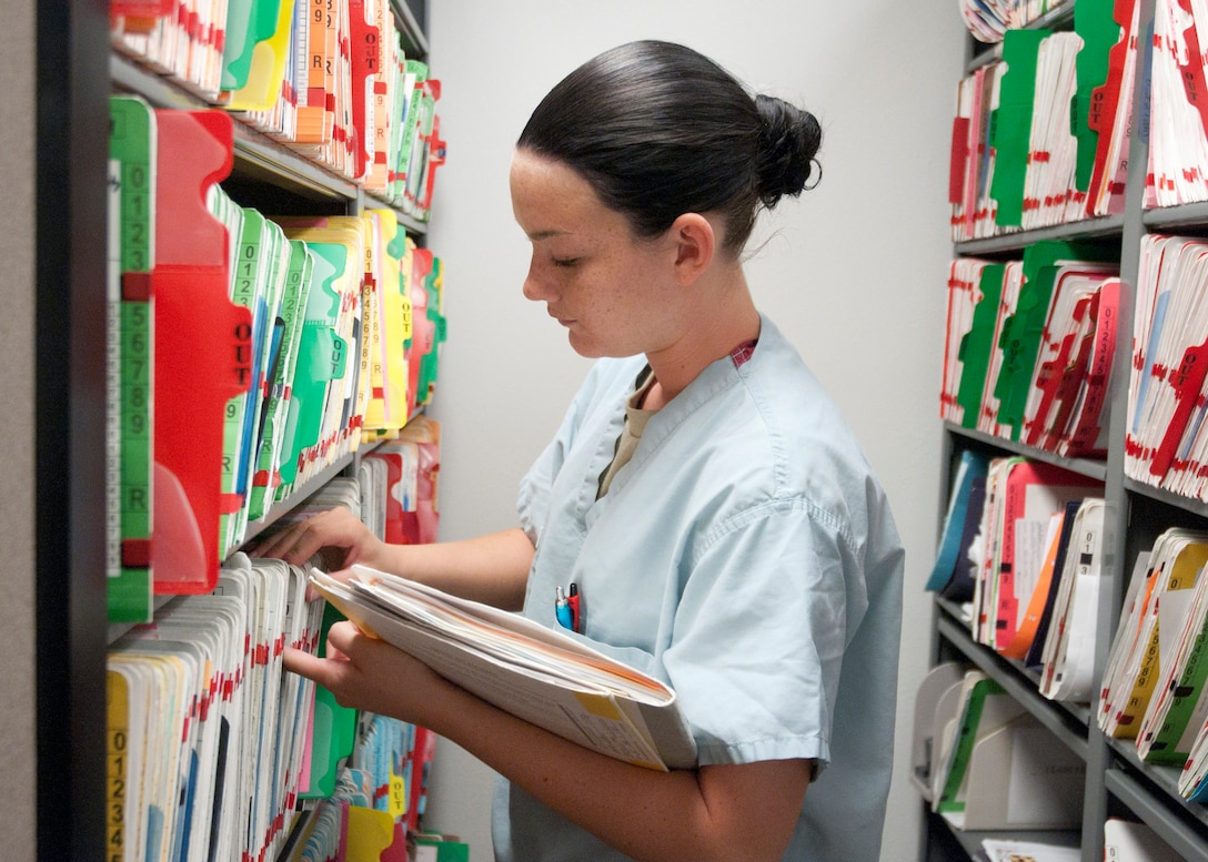 Airman 1st Class Whitney Erickson, 90th Medical Group dental assistant, searches for medical records July 8, 2014, at the 90th MDG Medical Treatment Facility on F.E. Warren Air Force Base, Wyo. The 90th Medical Group is an outpatient clinic which offers a variety of care, ensuring excellent health and welfare of all beneficiaries. (U.S. Air Force photo by Airman Malcolm Mayfield)