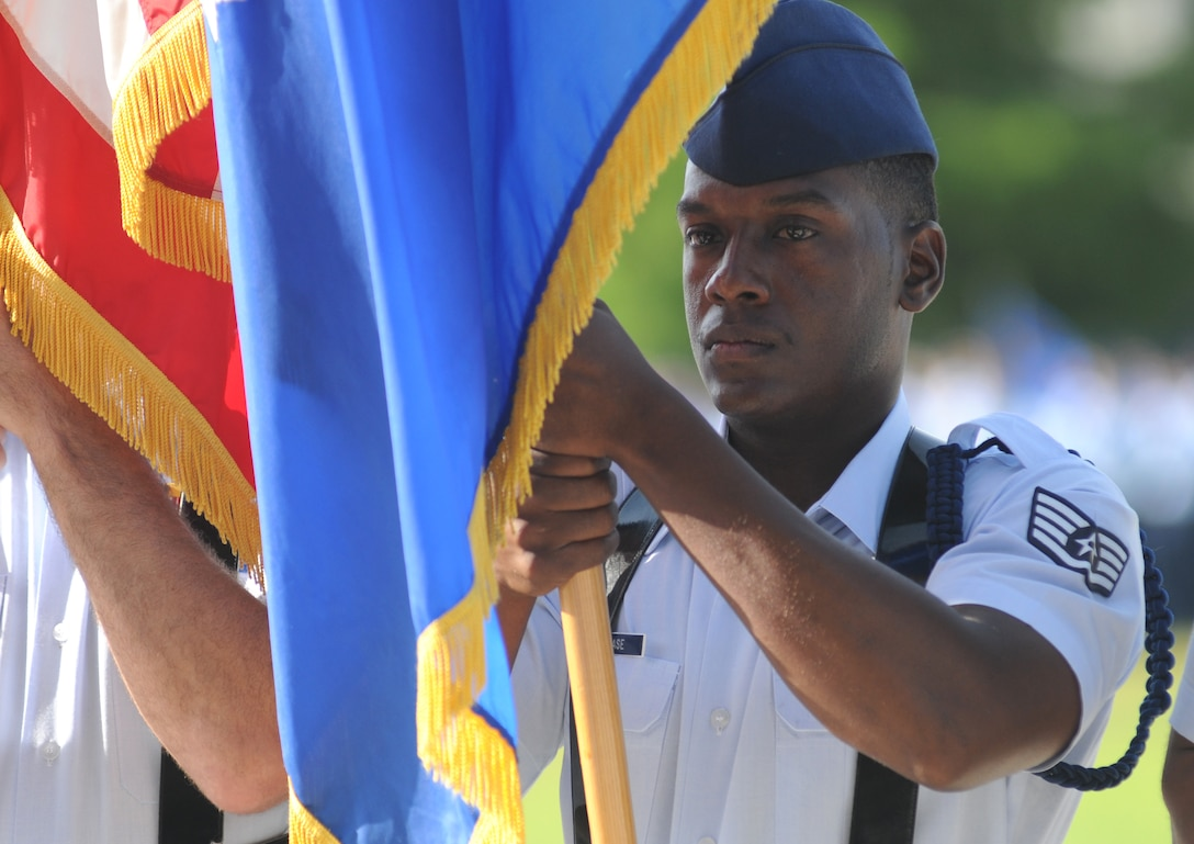 Staff Sgt. Jamarvis Rease, 338th Training Squadron military training leader, holds the Air Force flag during the 2nd Air Force change of command ceremony July 3, 2014, at Keesler Air Force Base, Miss.  Brig. Gen. Mark Brown assumed command at the ceremony from Maj. Gen. Leonard Patrick. Brown was previously the Financial Management director, Headquarters Air Force Material Command at Wright-Patterson Air Force Base, Ohio. Patrick is headed to Randolph Air Force Base, Texas, where he will become the AETC vice commander.  (U.S. Air Force photo by Kemberly Groue)