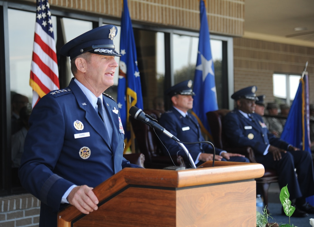 Gen. Robin Rand, commander of Air Education and Training Command, delivers remarks during the 2nd Air Force change of command ceremony July 3, 2014, at Keesler Air Force Base, Mississippi, as Maj. Gen. Leonard Patrick, outgoing 2nd Air Force commander, and Brig. Gen. Mark Brown, incoming commander, look on.  Patrick is headed to Joint Base San Antonio-Randolph, Texas, where he will become the AETC vice commander. Brown was previously the Financial Management director, Headquarters Air Force Material Command at Wright-Patterson Air Force Base, Ohio. (U.S. Air Force photo by Kemberly Groue)