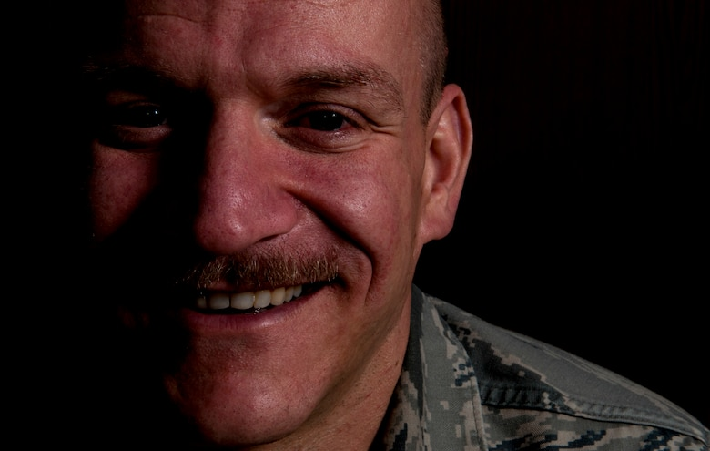 U.S. Air Force Master Sgt. Donald Stichter, 52nd Equipment Maintenance Squadron NCO in charge of munitions inspection from Lakewood, Colo., smiles for a portrait July 3, 2014, at Spangdahlem Air Base, Germany. To help train for the ING Luxembourg Night Marathon, Stichter used all four pillars of comprehensive fitness: mental, physical, spiritual, and social. (U.S. Air Force photo by Senior Airman Rusty Frank/Released)