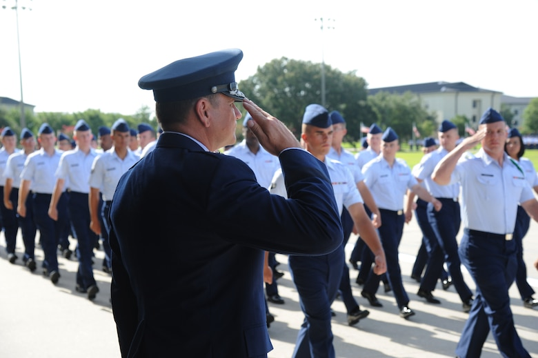 Maj. Gen. Leonard Patrick, outgoing 2nd Air Force commander, renders a salute as troops march during pass and review following the 2nd Air Force change of command ceremony July 3, 2014, at Keesler Air Force Base, Miss.  Patrick is replaced by Brig. Gen. Mark Brown was previously the Financial Management director, Headquarters Air Force Material Command at Wright-Patterson Air Force Base, Ohio. (U.S. Air Force photo by Kemberly Groue)