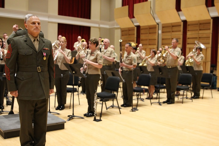On July 3, 2014, French horn section leader Master Gunnery Sgt. John Troxel was awarded the Meritorious Service Medal and retired from the Marine Band after 30 years of service. (U.S. Marine Corps photo by Master Sgt. Kristin duBois/released)