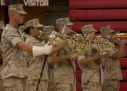 U.S. Marines with the 2nd Marine Division Band perform during the 26th Marine Expeditionary Unit (MEU) change of command ceremony aboard Camp Lejeune, N.C., June 25, 2014. Col. Matthew G. St. Clair relinquished command of the 26th MEU to Col. Robert C. Fulford. (U.S. Marine Corps photo by Lance Cpl. Joshua W. Brown/Released)
