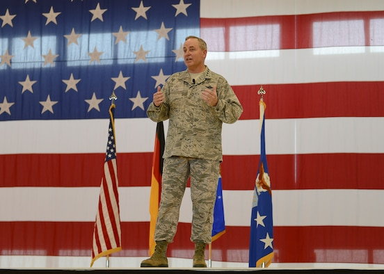 Air Force Chief of Staff Gen. Mark A. Welsh III, speaks during an all call July 8, 2014, Ramstein Air Base, Germany. Welsh and his wife, Betty, visited to interact with Airmen and discuss the state of the Air Force as well as gaining a better understanding of the responsibilities of Ramstein. As the senior uniformed Air Force officer, he is responsible for the organization, training and equipping of 690,000 active-duty, Guard, Reserve and civilian forces serving in the United States and overseas. Prior to his current position, he was U.S. Air Forces in Europe Commander. (U.S. Air Force photo/Airman 1st Class Michael Stuart)