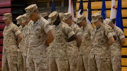 U.S. Marines and Sailors assigned to the 26th Marine Expeditionary Unit (MEU) participate in a pre-ceremonial prayer during the 26th MEU change of command ceremony aboard Camp Lejeune, N.C., June 25, 2014. Col. Matthew G. St. Clair relinquished command of the 26th MEU to Col. Robert C. Fulford. (U.S. Marine Corps Photo by Lance Cpl. Joshua W. Brown, 26th MEU Public Affairs/ Released)