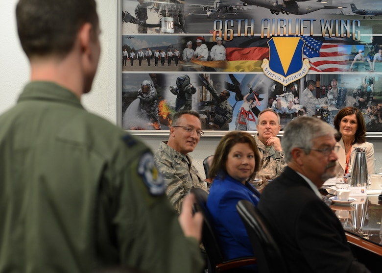 Air Force Chief of Staff Gen. Mark A. Welsh III, listens as Capt. Kyle Gauthier, 37th Airlift Sq. pilot, asks a question during a mission brief July 8, 2014, Ramstein Air Base, Germany. Welsh and his wife, Betty, visited to interact with Airmen and discuss the state of the Air Force as well as gaining a better understanding of the responsibilities of Team Ramstein. As the senior uniformed Air Force officer, he is responsible for the organization, training and equipping of 690,000 active-duty, Guard, Reserve and civilian forces serving in the United States and overseas. Prior to his current position, he was U.S. Air Forces in Europe Commander. (U.S. Air Force photo/Airman 1st Class Michael Stuart)
