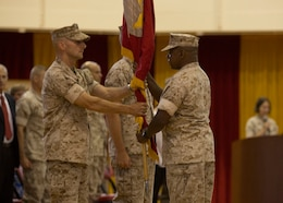 U.S. Marine Corps Col. Matthew G. St. Clair, the outgoing commanding officer of the 26th Marine Expeditionary Unit (MEU) receives the unit's organization colors from Master Gunnery Sgt. Jeffery N. Davis, 26th MEU operations chief, during a change of command ceremony aboard Camp Lejeune, N.C., June 25, 2014. Col. Matthew G. St. Clair relinquished command of the 26th MEU to Col. Robert C. Fulford. (U.S. Marine Corps Photo by Lance Cpl. Joshua W. Brown, 26th MEU Public Affairs/ Released)