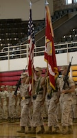 U.S. Marines assigned to the 26th Marine Expeditionary Unit (MEU) present the colors during the unit's change of command ceremony aboard Camp Lejeune, N.C., June 25, 2014. Col. Matthew G. St. Clair relinquished command of the 26th MEU to Col. Robert C. Fulford. (U.S. Marine Corps Photo by Lance Cpl. Joshua W. Brown, 26th MEU Public Affairs/ Released)