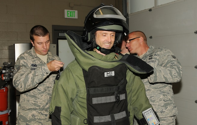 Staff Sgt. Chris Johnson (left) and Senior Airman Chris Cunningham (right), explosive ordnance disposal technicians with the 151st Civil Engineering Squadron, put a bomb suit on Lt. Col. Timo Diegmueller during his tour of the Utah Air National Guard EOD unit. Diegmueller, a Reserve intelligence officer with the German Air Force, visited the Air Guard Base in Salt Lake City while participating in the Department of Defense Reserve Officers Foreign Exchange Program. (Utah Air National Guard Photo by Staff Sgt. Annie Edwards/RELEASED)