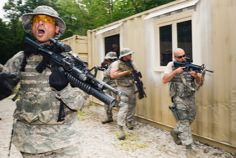 U.S. Airmen from the 116th Security Forces Squadron (SFS), Georgia Air National Guard, take part in counterinsurgency operations, or COIN, training at the Catoosa Training Site, Tunnel Hill, Ga., June 29, 2014. The 116th SFS deployed to the Catoosa Training Site for annual training where they received extensive classroom and hands-on training to hone their skills on various firearms such as the M4 carbine, M203 grenade launcher and M240 and M249 machine guns as well as training in various security operations performed by Air Force security forces personnel. During COIN training, the Security Forces Airmen used a simulated local village to practice building breaching and clearing operations as well as working with the local populace while encountering simulated threats. (U.S. Air National Guard photo by Master Sgt. Roger Parsons/Released)