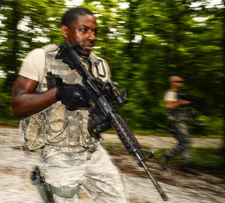 U.S. Air Force Senior Airman Fitzgerald Wiggleton, a member of the 116th Security Forces Squadron (SFS), Georgia Air National Guard, takes part in counterinsurgency operations, or COIN, training at the Catoosa Training Site, Tunnel Hill, Ga., June 29, 2014. The 116th SFS deployed to the Catoosa Training Site for annual training where they received extensive classroom and hands-on training to hone their skills on various firearms such as the M4 carbine, M203 grenade launcher and M240 and M249 machine guns as well as training in various security operations performed by Air Force security forces personnel. During COIN training, the Security Forces Airmen used a simulated local village to practice building breaching and clearing operations as well as working with the local populace while encountering simulated threats. (U.S. Air National Guard photo by Master Sgt. Roger Parsons/Released)
