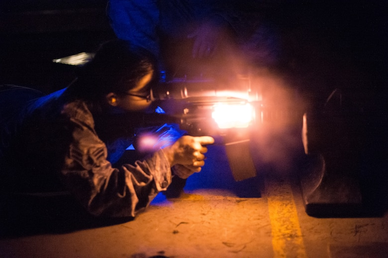 U.S. Air Force Airman 1st Class Paula Helms, a member of the 116th Security Forces Squadron (SFS), Georgia Air National Guard, fires an M4 carbine rifle during a night time training exercise at the Catoosa Training Site, Tunnel Hill, Ga., June 25, 2014. The 116th SFS is the security arm of the 116th Air Control Wing based at Robins Air Force Base, Ga. The squadron deployed to the Catoosa Training Site for annual training where they received extensive classroom and hands-on training to hone their skills on various firearms such as the M4 carbine, M203 grenade launcher and M240 and M249 machine guns. (U.S. Air National Guard photo by Master Sgt. Roger Parsons/Released)