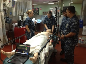 Sailors assigned to USNS Mercy conduct medical assessment training July 7, 2014, during the in-port phase of Rim of the Pacific 2014 in preparation for the humanitarian assistance and disaster relief portion of the exercise. U.S. Navy photo by Capt. Dora Lockwood