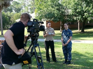 Navy Lt. Marquette Leveque, right, prepares for an interview with Navy Petty Officer 2nd Class Ashley Hedrick at Naval Submarine Base Kings Bay, Georgia, July 9, 2014. Leveque, one of the Navy's first women to serve aboard a submarine, said the transition has been smooth in the formerly all-male submariner community. DoD photo