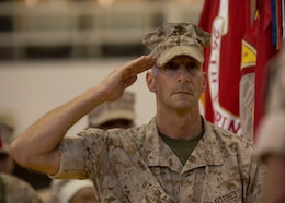 U.S. Marine Corps Col. Matthew G. St. Clair, the outgoing commanding officer of the 26th Marine Expeditionary Unit (MEU) salutes after taking his post during the unit's change of command ceremony aboard Camp Lejeune, N.C., June 25, 2014. Col. Matthew G. St. Clair relinquished command of the 26th MEU to Col. Robert C. Fulford. (U.S. Marine Corps Photo by Lance Cpl. Joshua W. Brown, 26th MEU Public Affairs/ Released)