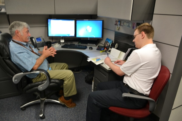 Employee Stephan Hake speaks with Will Heuser during the STEM shadowing experience