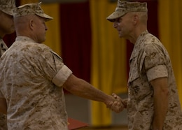 U.S. Marine Corps Maj. Gen. Raymond C. Fox, commanding general of II Marine Expeditionary Force, congratulates Col. Matthew G. St. Clair, the outgoing commanding officer of the 26th Marine Expeditionary Unit (MEU), after presenting him the Legion of Merit medal during the 26th MEU change of command ceremony aboard Camp Lejeune, N.C., June 25, 2014. Col. Matthew G. St. Clair relinquished command of the 26th MEU to Col. Robert C. Fulford. (U.S. Marine Corps Photo by Lance Cpl. Joshua W. Brown, 26th MEU Public Affairs/ Released)