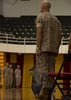 U.S. Marine Corps Col. Matthew G. St. Clair, the outgoing commanding officer of the 26th Marine Expeditionary Unit (MEU), stands at attention as the Marines Hymn is performed during the unit's change of command ceremony aboard Camp Lejeune, N.C., June 25, 2014. Col. Matthew G. St. Clair relinquished command of the 26th MEU to Col. Robert C. Fulford. (U.S. Marine Corps Photo by Lance Cpl. Joshua W. Brown, 26th MEU Public Affairs/ Released)