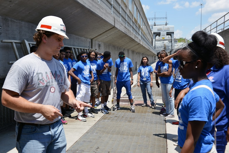 Will Garner, an Old Hickory Hydropower trainee at the Old Hickory Lock and Dam from the Nashville District provides students from the National Summer Transportation Institute program with information about the operations of the Old Hickory Lock and Dam on June 30, 2014.
