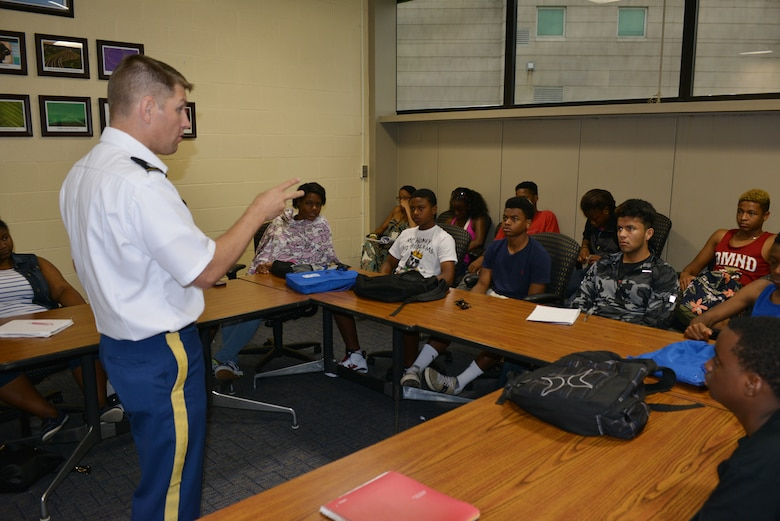Lt. Col. John L. Hudson, Commander of the Nashville District talks with students attending the National Summer Transportation Institute program June 30,, 2014 on a variety of engineering classes and current district projects during a lecture on the campus of Tennessee State University.    The students received briefings on Corps leadership, engineering, structures, projects, mobility, engineer jobs, lock and dams, watersheds, Corps operating processes' and interacted with engineers and subject matter experts during a tour at the Old Hickory Lock and Dam in Hendersonville,