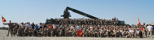 Marines and civilian contractors with Redeployment and Retrograde in support of Reset and Reconstitution Operations Group pose for a unit photo recently during their current deployment to Camp Leatherneck, Helmand province, Afghanistan. The unit was established aboard the base during April 2012, tasked with the significant role as the unit responsible to retrograde all Marine Corps gear home from Afghanistan.