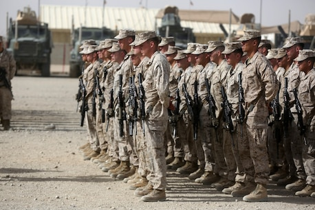 Marines with 1st Battalion, 7th Marine Regiment, stand at parade rest during a memorial ceremony aboard Camp Leatherneck, July 2, 2014. The memorial was in honor of Sgt. Thomas Z. Spitzer, a professionally instructed gunman with Scout Sniper Platoon, 1st Bn., 7th Marines, who was killed while conducting combat operations in Helmand province, Afghanistan, June 25, 2014. (U.S. Marine Corps photo by Cpl. Joseph Scanlan / released)