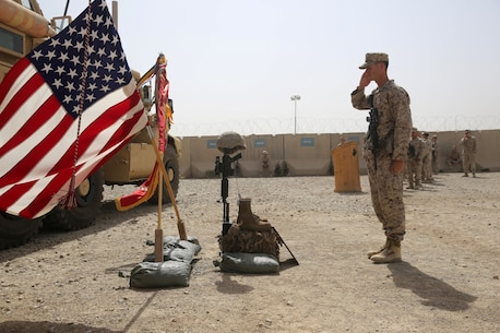 Sergeant Louis Wood, scout sniper, Scout Sniper Platoon, 1st Battalion, 7th Marine Regiment, and a native of Fort Worth, Texas, salutes a battlefield cross during a memorial ceremony aboard Camp Leatherneck, July 2, 2014. The memorial was in honor of Sgt. Thomas Z. Spitzer, a professionally instructed gunman with Scout Sniper Platoon, 1st Bn., 7th Marines, who was killed while conducting combat operations in Helmand province, Afghanistan, June 25, 2014. (U.S. Marine Corps photo by Cpl. Joseph Scanlan / released)