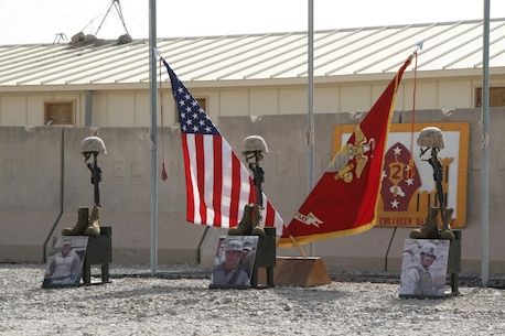 Three battlefield crosses stand in honor of three fallen Marines during a memorial ceremony aboard Camp Leatherneck, Afghanistan, July 8, 2014. The service was held to honor, from left to right, Staff Sgt. David H. Stewart, a combat engineer, platoon sergeant and native of Stafford, Virginia; Cpl. Brandon J. Garabrant, a combat engineer and native of Peterborough, New Hampshire; and Cpl. Adam F. Wolff, a combat engineer and native of Cedar Rapids, Iowa, all Marines serving with 3rd Platoon, Route Clearance Company, 2nd Combat Engineer Battalion, who gave the ultimate sacrifice while conducting combat operations in Helmand province, Afghanistan, June 20, 2014.